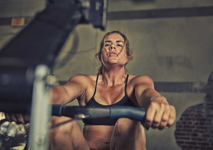female athlete on the rowing machine